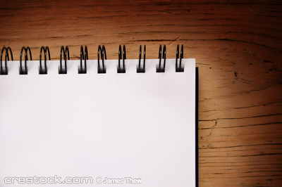 a blank writing pad on a table.